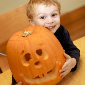 Young boy and jack o' lantern